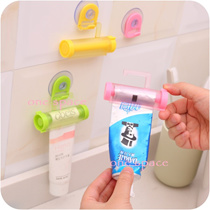 [One Space] Practical Creative rolling squeezer toothpaste Dispenser Tube Partner Sucker Hanging Holder bathroom set/ideal of good
