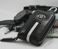 New Elegant White Leather Car Key Pouch With Stainless Steel Belt Clip. Various Car Brands Available. Durable and Convenient.