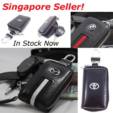 New Elegant Leather Car Key Pouch With Stainless Steel Belt Clip. Various Car Brands Available. Durable and Convenient.