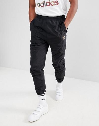 cb1bc4f5c42 Qoo10 - adidas Originals x Pharrell Williams Hu Hiking Joggers In Black  CY7868 : Men's Clothing