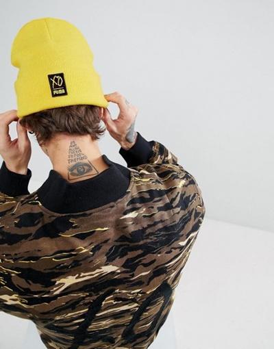 fdb797770a1 Qoo10 - Puma x XO Beanie In Yellow 02161301   Fashion Accessories