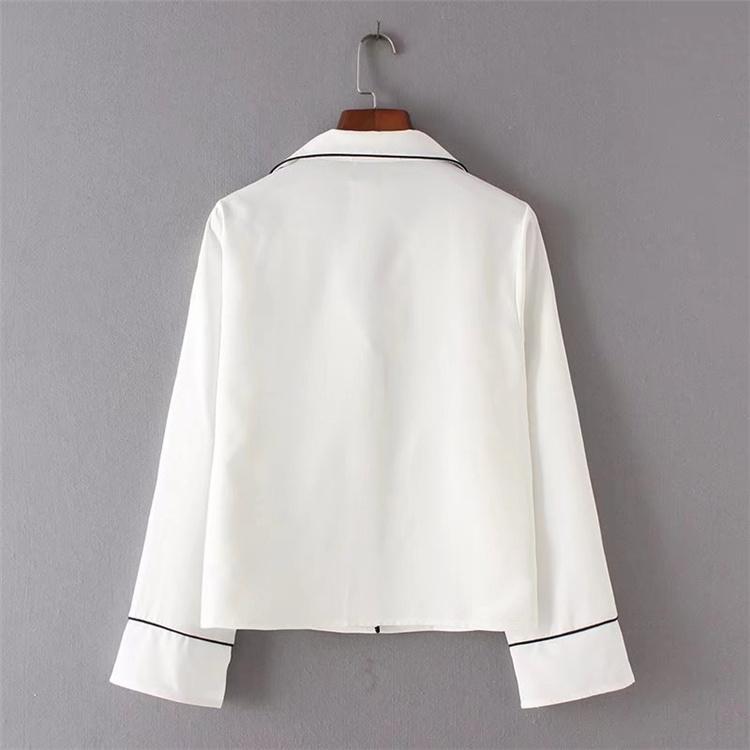 夏の新型の欧米風の白色のパジャマ式の上着の刺繍はゆったりして長袖のシフォンシャツを刺繍して