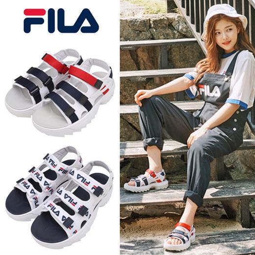 fila disruptor sandals on feet
