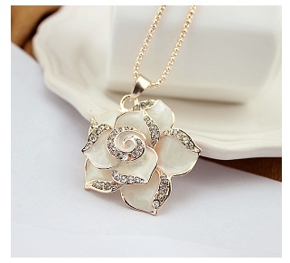 Gold and black enamel rose pendant necklace with crystal